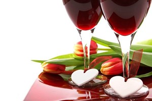 red_and_yellow_anniversary_tulips_with_two_glasses_of_red_wine